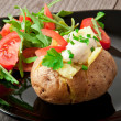 Royalty-Free Stock Photo: Baked potato filled with sour cream and arugula