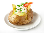 Baked potato filled with sour cream and arugula — Stock Photo