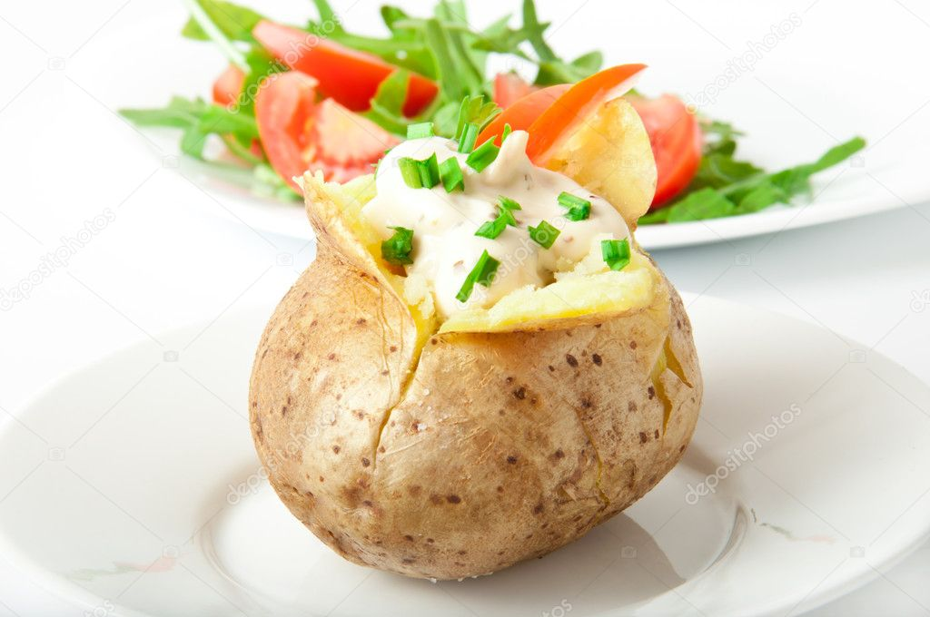 Baked potato filled with sour cream and arugula — Stock Photo #11132422