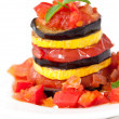 Royalty-Free Stock Photo: Delicious Ratatouille on a white plate decorating with a leaf of basil