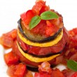 Delicious Ratatouille on a white plate decorating with a leaf of basil — Stock Photo