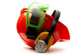 Red safety helmet with earphones — Stock Photo