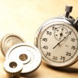 Stock Photo: Mechanical ratchets and stopwatch