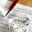 Application form with stopwatch and pen — Stock Photo