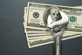 Spanner and dollars — Stock Photo