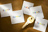 Cards with different languages and key — Stock Photo