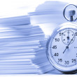 Pile of paper cards and stopwatch in blue — Stock Photo #11566581