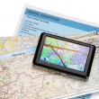 Road map and navigator — Stock Photo
