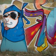 Art of graffiti on the street wall — Stock Photo #11566778