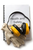Health and safety register with earphones — Stock Photo