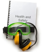 Health and safety register with goggles and earphones — Zdjęcie stockowe