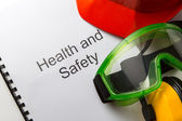 Register with goggles, earphones and helmet — Stock Photo