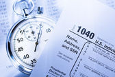 Tax form, operating budget and stopwatch — Stock Photo