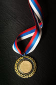 Metal medal with tricolor ribbon — Stock Photo