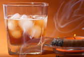 Scotch whiskey, a cigar and a candle. — Stock Photo