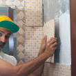 Tile adhesive installation - Stock Photo
