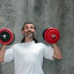 Happy man lifting dumbbell — Stock Photo #11117206