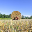 Hay bale sitting man — Stock Photo #11849527