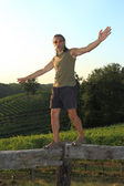 Equilibrist over vineyards — Stock Photo