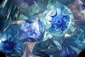 Blue plastic bottles — Stock Photo