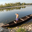 Boat oarsman on river — Stockfoto