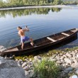Oarsman on river — Stock Photo