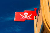 Pirate flag on plaything — Stock Photo