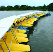 Yellow and blue water-cycle boat in park — Stock Photo