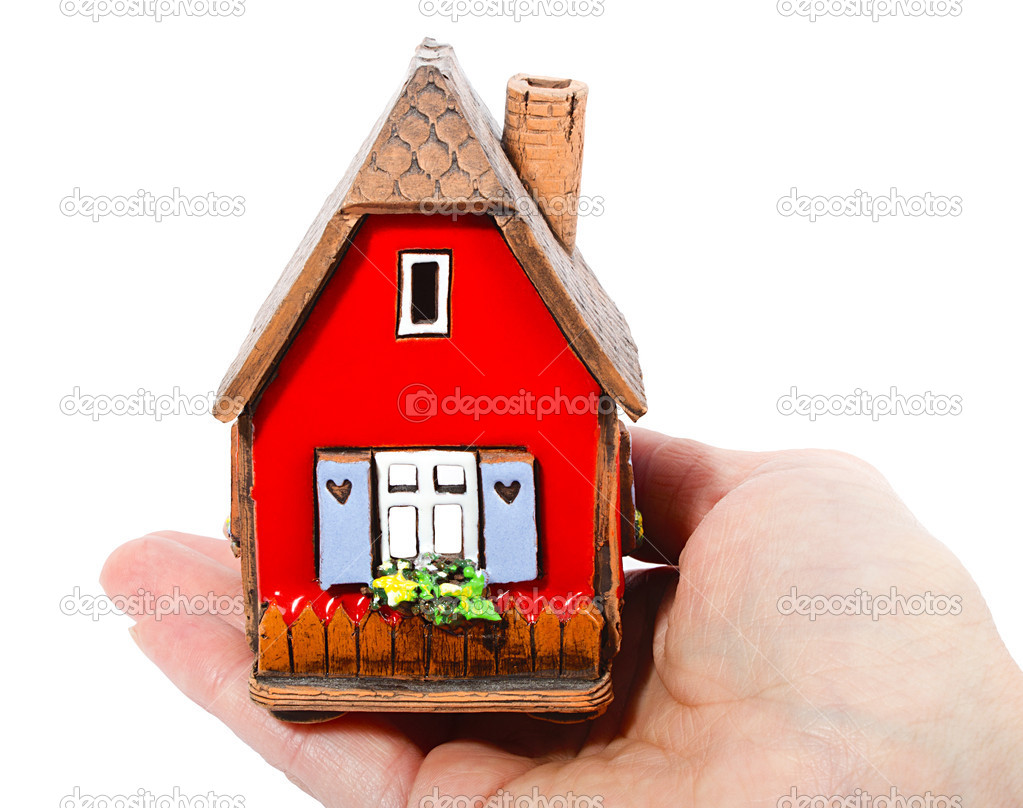 The house in human hands — Stock Photo #11849011