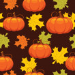 Seamless pattern of autumn leaves and pumpkins — 图库矢量图片