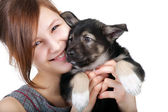 Beautiful woman with little puppy — Stock Photo