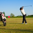 Playing golf on a driving range — Stock Photo