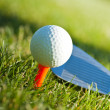 Playing golf. Golf club and ball. Preparing to shot — Stock Photo #10870103
