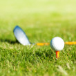 Close up on golf ball and golf club behind — Stock Photo