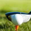 Close up on golf ball and golf club behind — Stockfoto