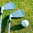 Golf clubs on grass — Stok fotoğraf