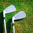 Golf clubs on grass - Stock Photo