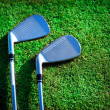 Royalty-Free Stock Photo: Golf clubs on grass
