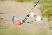Golf balls in bunker — Stock Photo