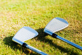Golf clubs on grass — Stock Photo