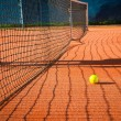 Tennis player on clay court — Stock Photo