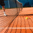 Tennis player on clay court - Stock Photo