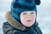 Closeup portrait von einem boyin winterkleidung mit glanz — Stockfoto