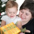 Toddler and her mom in christmas time — Stock Photo #11543206