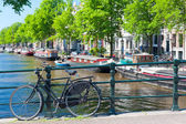 Bicycle on the bridge in Amsterdam — Stock Photo