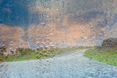 Road in mountain in rain — Stock Photo