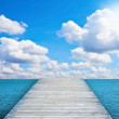 Cloudy sky and pier — Stock Photo
