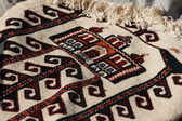 Handmade carpets for muslim prayer. — Stock Photo