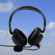 Headphone on blue sky as a background — Stock Photo