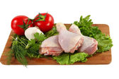 Raw chicken thighs with vegetables — Stock Photo